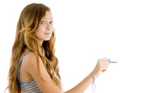 teenager posing with key isolated on white background photo
