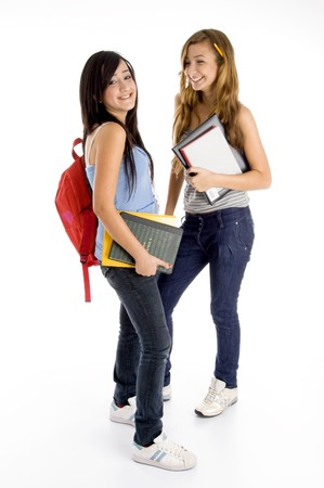 standing young students posing with bag and books with white background Stock Photo