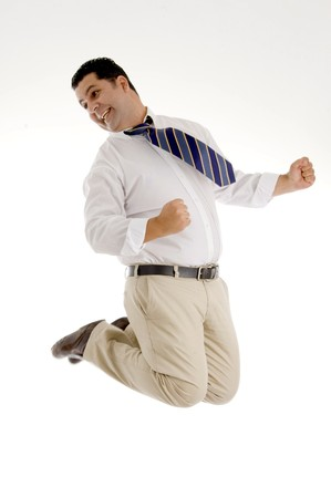 successful businessman jumping high in air on an isolated white background photo