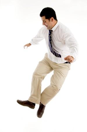 winning businessman having fun in mid air against white background photo