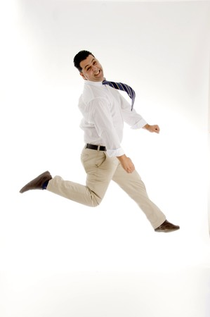 businessman leaping in mid of air with white background photo