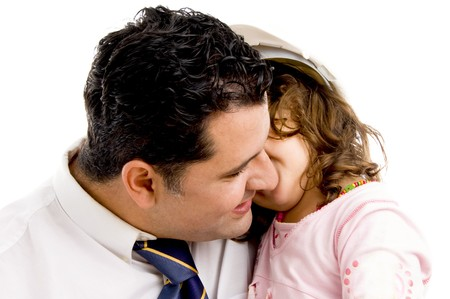 father cuddling his daughter wearing hardhat on an isolated white background photo