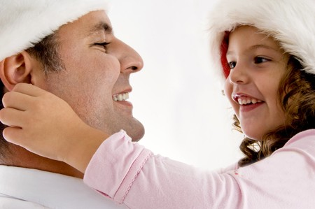girl pulling fathers ears isolated on white background photo