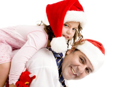 father and daughter posing wearing santa hats on an isolated white background photo