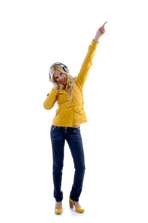 front view of standing woman enjoying music on an isolated white background photo