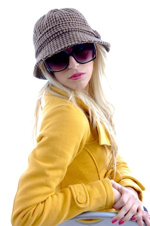 side view of model with cap and sunglasses on an isolated background photo