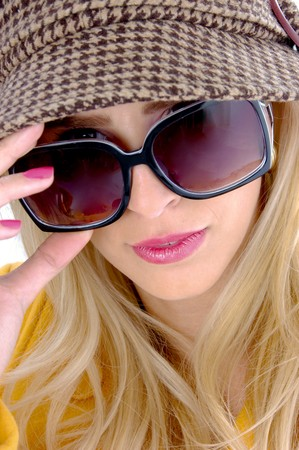 close view of model wearing sunglasses photo