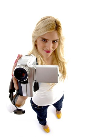 high angle view of smiling model with camcorder on an isolated background