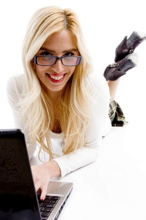front view of smiling businesswoman working on laptop on an isolated white background photo