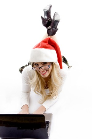 front view of female wearing christmas hat working on laptop against white background Stock Photo - 3972193