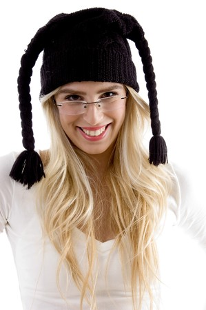 front view of smiling woman in woolen cap on an isolated background photo