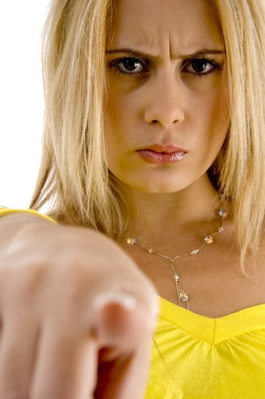 only mature women: angry female pointing at camera with white background Stock Photo