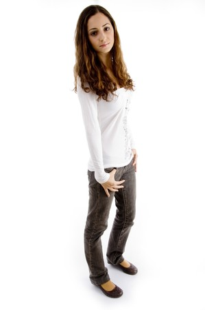 18: fashionable teen girl posing and looking at camera with white background