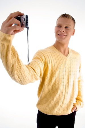 standing male with camera on an isolated white background photo
