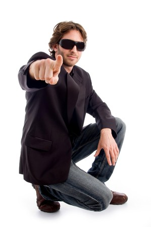pointing sitting male on an isolated white background