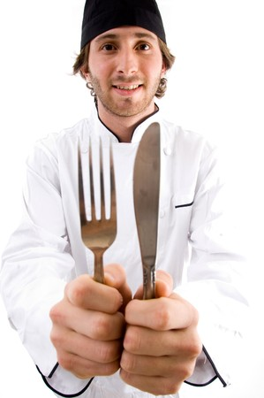 smiling chef showing knife and fork against white background photo