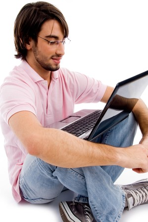 young man working on laptop on an isolated background photo