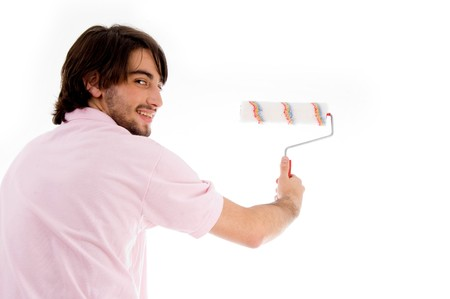 back pose of man with paint roller with white background photo