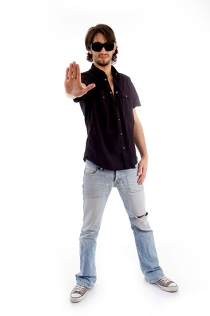 standing male showing stopping hand gesture against white background photo