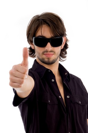 handsome male showing thumbs up on an isolated white background photo
