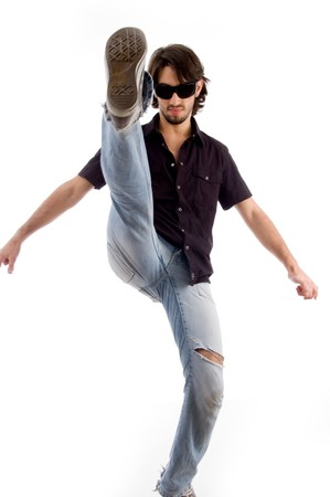 smart male kicking high with white background photo