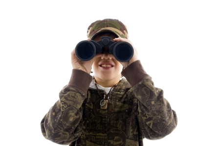 schoolkid search: front view boy looking through binoculars against white background Stock Photo