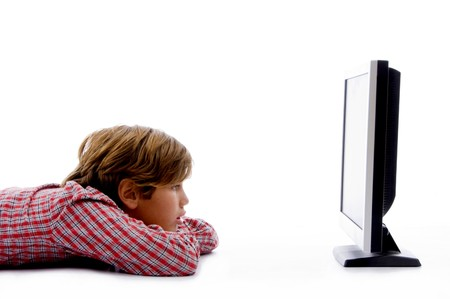 10s: side pose of boy watching tv on an isolated white background Stock Photo