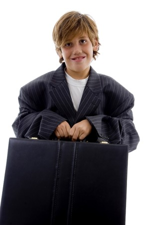 front view of tired young businessman holding briefcase on an isolated background photo