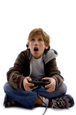 front view of amazed kid playing computer game on an isolated white background