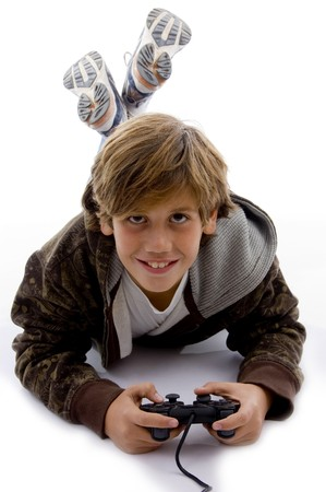 front view of smiling young boy with joystick against white background