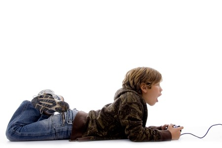 side view of shocked boy playing videogame with white background