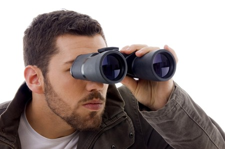 side view of man looking through binoculars on an isolated background photo