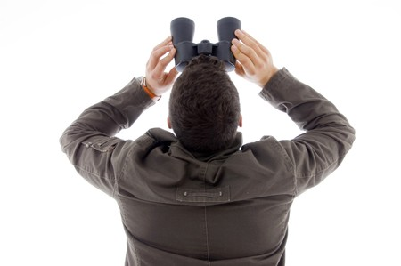 back pose of man using a pair of binoculars against white background photo