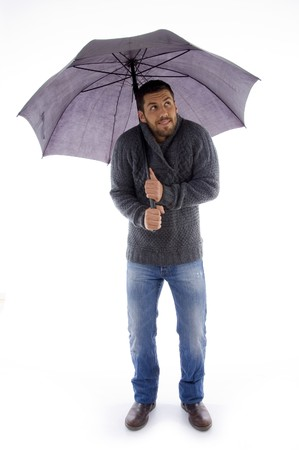 front view of man holding an umbrella and looking up on an isolated white background photo