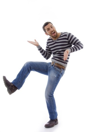 side view of amused man dancing against white background photo