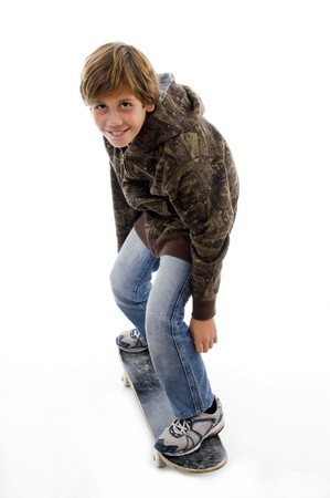 side pose of boy riding skate on an isolated background photo