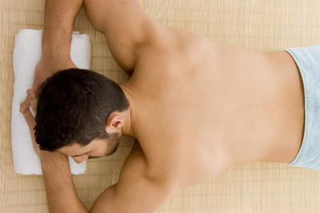 high angle view of man lying down for spa treatment  photo