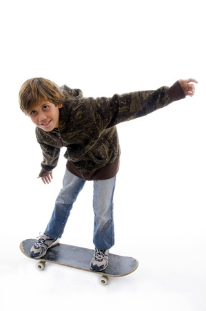 10s: front view of boy riding skate  with white background Stock Photo