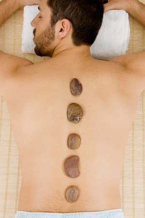 high angle view of man receiving hot stone massage