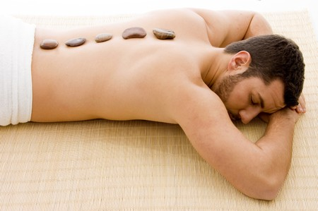 high angle view of man lying down on mat at spa  Stock Photo
