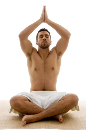 front view of male performing yoga on an isolated background