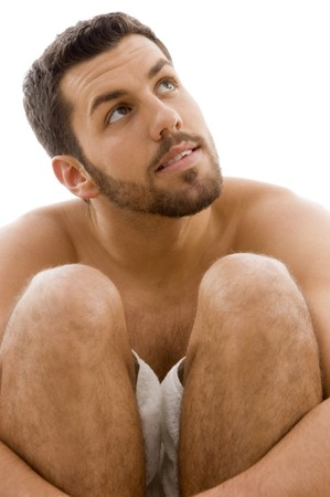 EASE: front view of man in towel looking sideways front view of man in towel on an isolated background