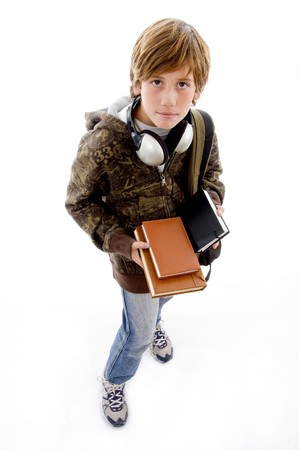 top view of school boy looking at camera against white background photo