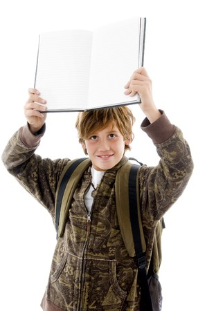 front view of school boy showing copy on an isolated background photo