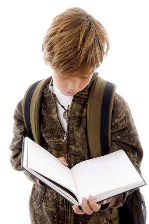 front view of school child reading with white background photo