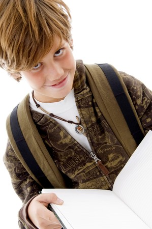 front view of smiling school child reading on an isolated white background photo