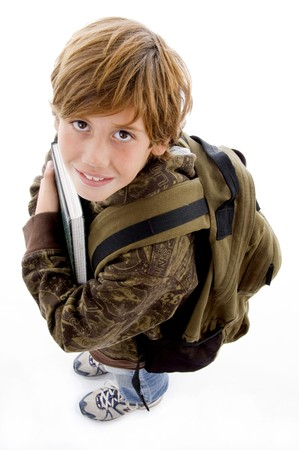 high angle view of school boy looking at camera against white background photo