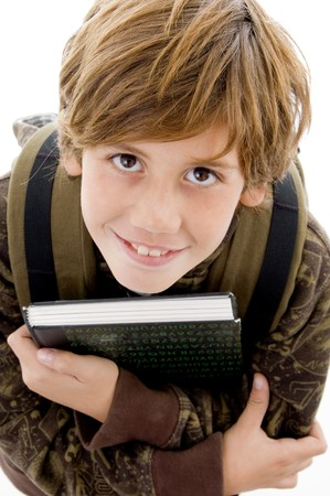 high angle view of smiling school boy looking at camera on an isolated background photo
