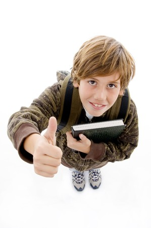 10s: high angle view of smiling school boy with thumbs up with white background