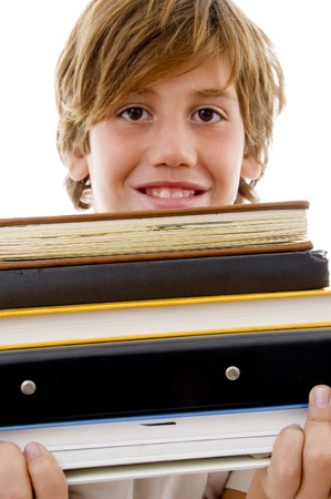 front view of smiling boy holding books on an isolated white background photo